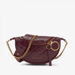 Túi Đeo Vai Charles & Keith Wrinkled Patent Ring Zip Tassel Crossbody Bag Màu Đỏ Mận
